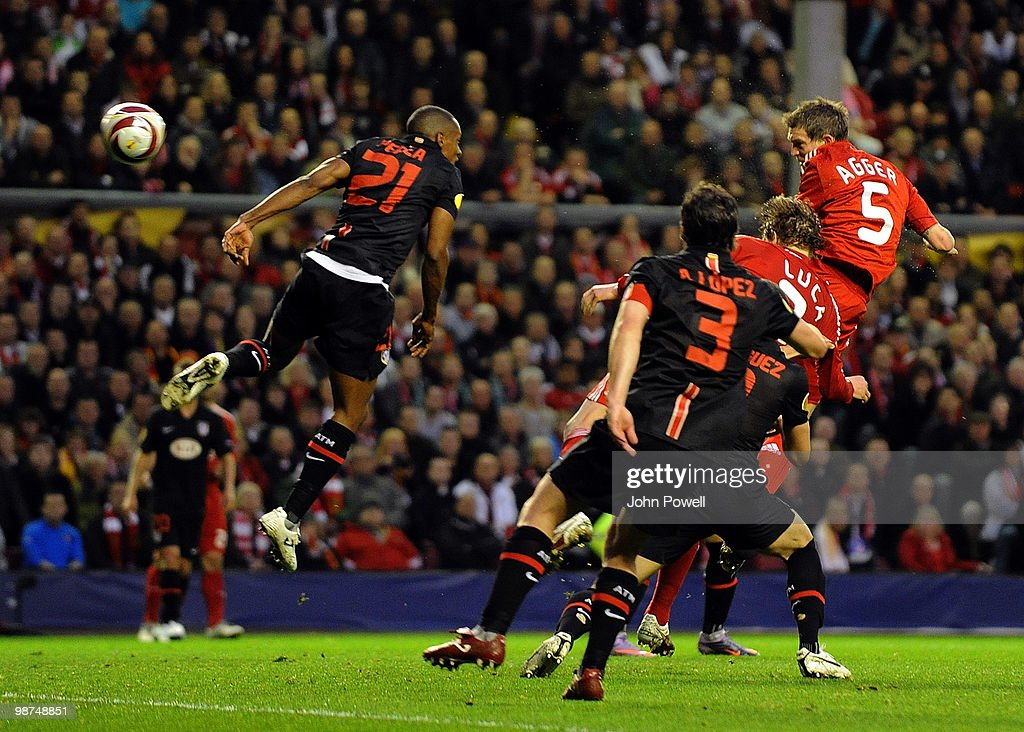 <a gi-track='captionPersonalityLinkClicked' href=/galleries/search?phrase=Daniel+Agger&family=editorial&specificpeople=605441 ng-click='$event.stopPropagation()'>Daniel Agger</a> of Liverpool scores an offside goal during the UEFA Europa League Semi-Final Second Leg match between Liverpool FC and Atletico Madrid at Anfield on April 29, 2010 in Liverpool, England.