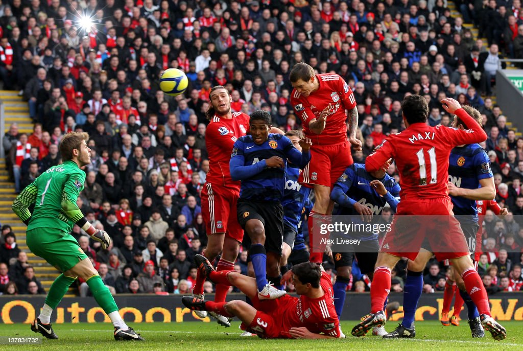 <a gi-track='captionPersonalityLinkClicked' href=/galleries/search?phrase=Daniel+Agger&family=editorial&specificpeople=605441 ng-click='$event.stopPropagation()'>Daniel Agger</a> of Liverpool scores the opening goal during the FA Cup Fourth Round match between Liverpool and Manchester United at Anfield on January 28, 2012 in Liverpool, England.