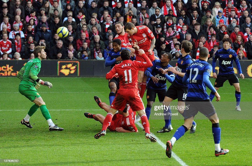 <a gi-track='captionPersonalityLinkClicked' href=/galleries/search?phrase=Daniel+Agger&family=editorial&specificpeople=605441 ng-click='$event.stopPropagation()'>Daniel Agger</a> of Liverpool scores to make it 1-0 during the FA Cup fourth round match between Liverpool and Manchester United at Anfield on January 28, 2012 in Liverpool, England.