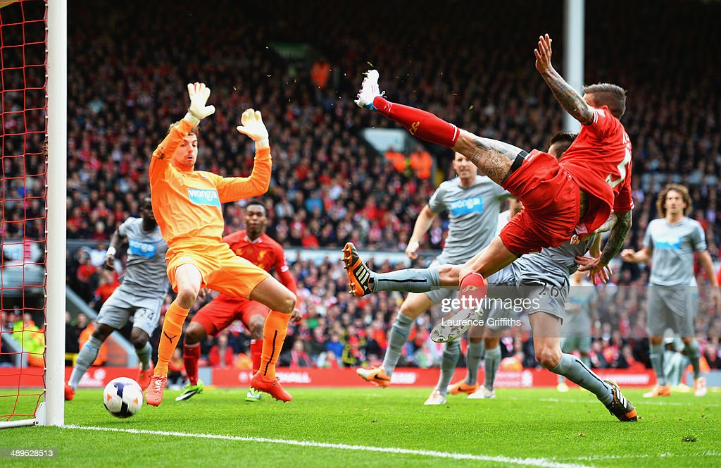<a gi-track='captionPersonalityLinkClicked' href=/galleries/search?phrase=Daniel+Agger&family=editorial&specificpeople=605441 ng-click='$event.stopPropagation()'>Daniel Agger</a> of Liverpool (5) shoots past <a gi-track='captionPersonalityLinkClicked' href=/galleries/search?phrase=Tim+Krul&family=editorial&specificpeople=618004 ng-click='$event.stopPropagation()'>Tim Krul</a> of Newcastle United to score their first goal during the Barclays Premier League match between Liverpool and Newcastle United at Anfield on May 11, 2014 in Liverpool, England.