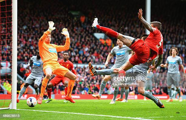 Daniel Agger of Liverpool shoots past Tim Krul of Newcastle United to score their first goal during the Barclays Premier League match between...