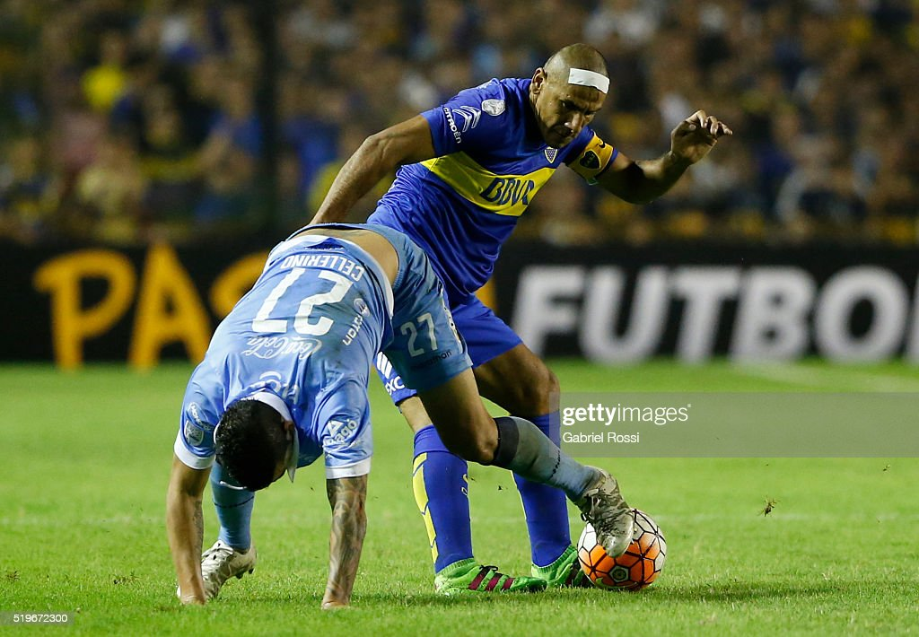 Daniel Alberto Diaz of Boca Juniors fights for the ball with Gaston Cellerino of Bolivar during a match between Boca Juniors and Bolivar as part of Group 3 of Copa Bridgestone Libertadores 2016 at Alberto J Armando Stadium on April 07, 2016 in Buenos Aires, Argentina.