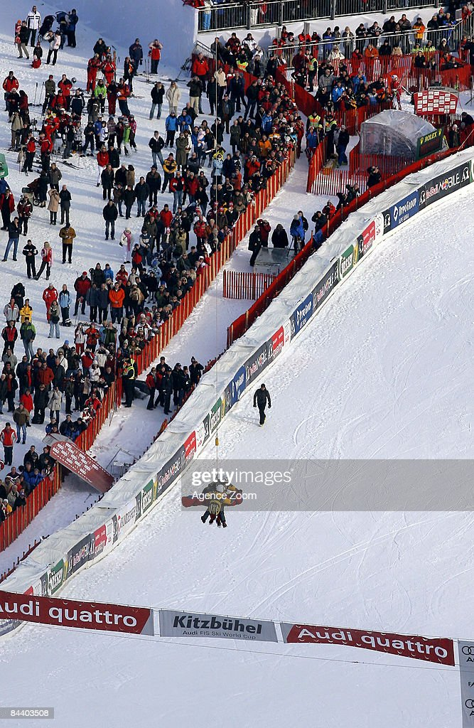 Daniel Albrecht of Switzerland receives medical treatment after falling in the finish jump during the Men's Downhill Training ahead the FIS Ski World...