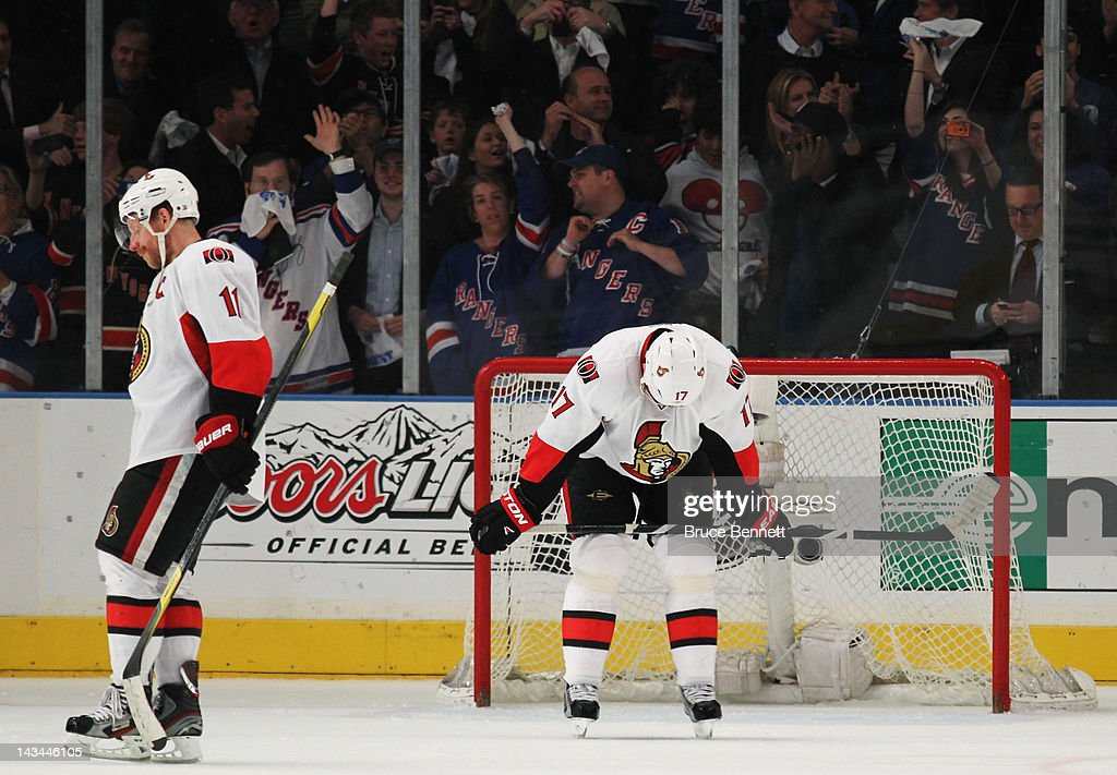 Daniel Alfredsson and Filip Kuba of the Ottawa Senators react to their 2 to 1 loss to the New York Rangers in Game Seven of the Eastern Conference...