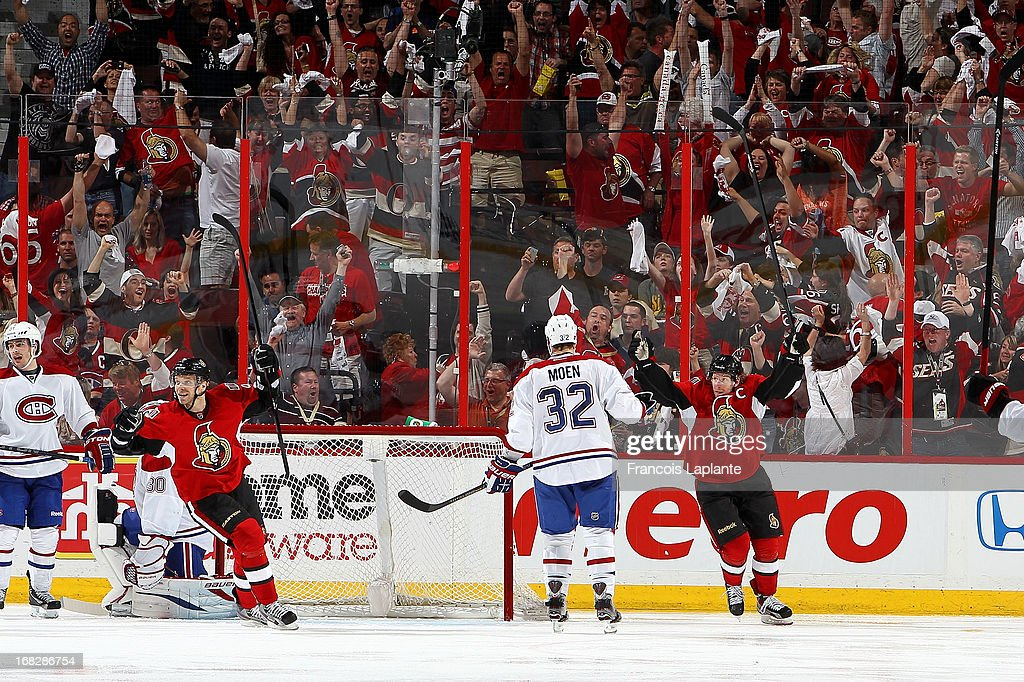 Daniel Alfredsson #11 and Milan Michalek #9 of the Ottawa Senators celebrate their overtime win as Travis Moen #32, Peter Budaj #30 and David Desharnais #51 of the Montreal Canadiens react in Game Four of the Eastern Conference Quarterfinals during the 2013 NHL Stanley Cup Playoffs at Scotiabank Place on May 7, 2013 in Ottawa, Ontario, Canada.