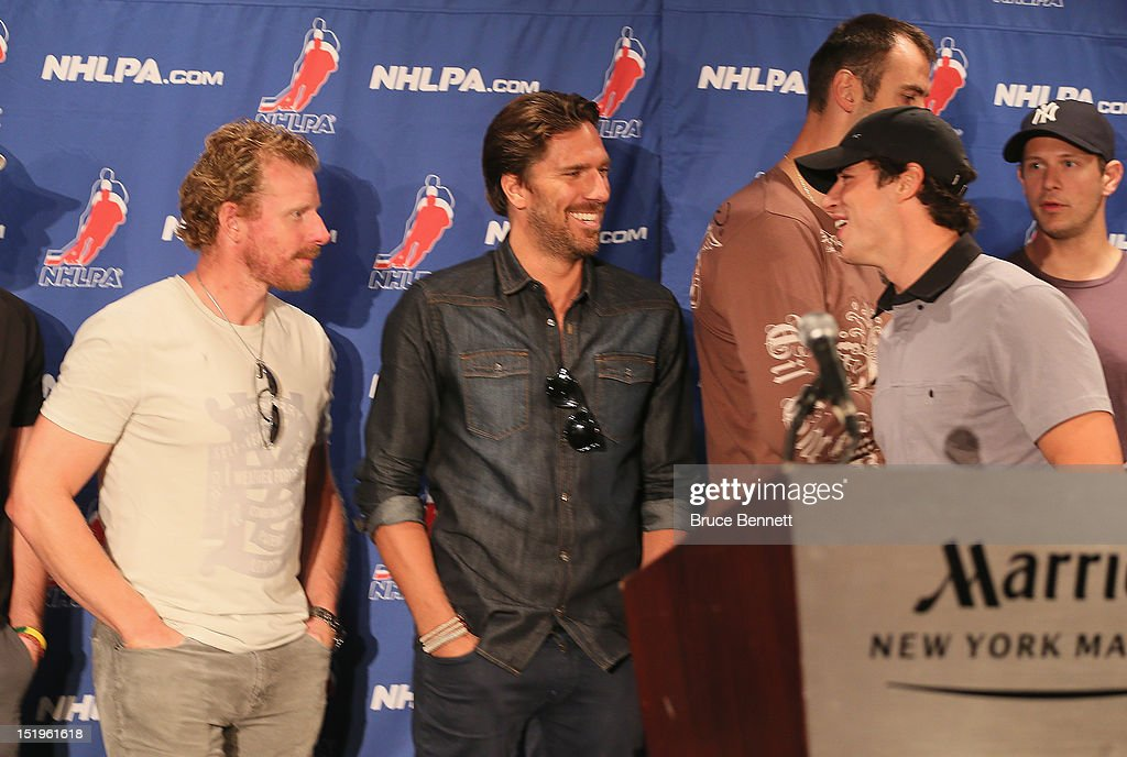 Daniel Alfredsson, Henrik Lundqvist and Sidney Crosby of the NHLPA take part in a press conference with the media at Marriott Marquis Times Square on September 13, 2012 in New York City.
