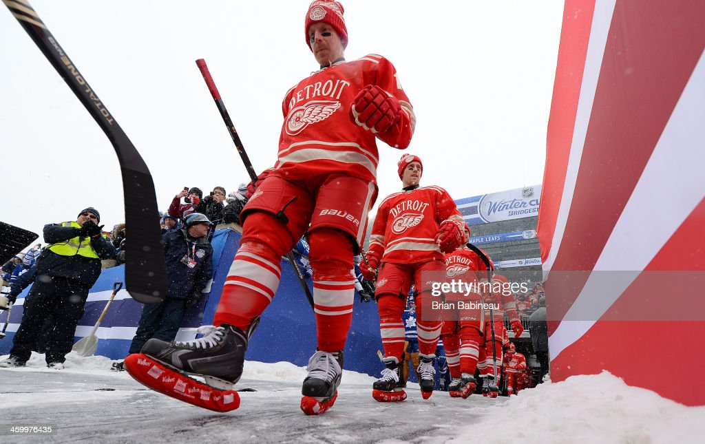 Daniel Alfredsson Joakim Andersson and their Detroit Red Wings teammates make their way to the ice surface for warmup prior to the 2014 Bridgestone...