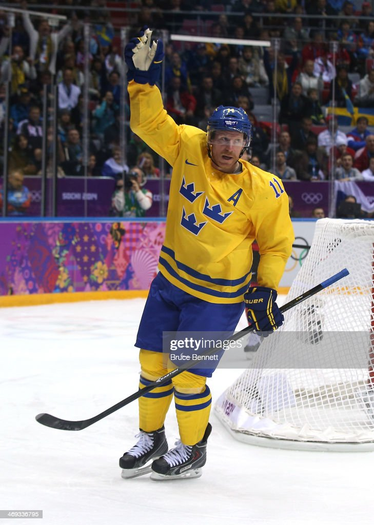 Daniel Alfredsson #11 of Sweden celebrates after a goal in the third period against Switzerland during the Men's Ice Hockey Preliminary Round Group C game on day seven of the Sochi 2014 Winter Olympics at Bolshoy Ice Dome on February 14, 2014 in Sochi, Russia.