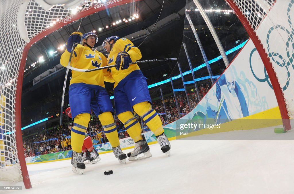 Daniel Alfredsson of Sweden celebrates his firstperiod goal against Belarus during the ice hockey men's preliminary game on day 8 of the Vancouver...