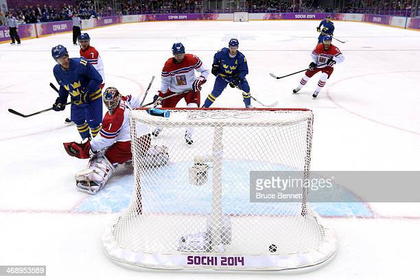Daniel Alfredsson of Sweden scores a goal in the first period against Jakub Kovar of Czech Republic during the Men's Ice Hockey Preliminary Round...
