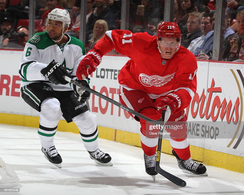 <a gi-track='captionPersonalityLinkClicked' href=/galleries/search?phrase=Daniel+Alfredsson&family=editorial&specificpeople=201853 ng-click='$event.stopPropagation()'>Daniel Alfredsson</a> #11 of the Detroit Red Wings and <a gi-track='captionPersonalityLinkClicked' href=/galleries/search?phrase=Trevor+Daley&family=editorial&specificpeople=213975 ng-click='$event.stopPropagation()'>Trevor Daley</a> #6 of the Dallas Stars skate back to the play from behind the net during an NHL game at Joe Louis Arena on November 7, 2013 in Detroit, Michigan. Dallas defeated Detroit 4-3 in OT