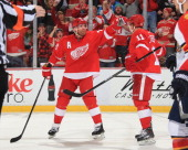 Daniel Alfredsson of the Detroit Red Wings celebrates a goal with teammate Daniel Cleary during an NHL game against the Florida Panthers on January...