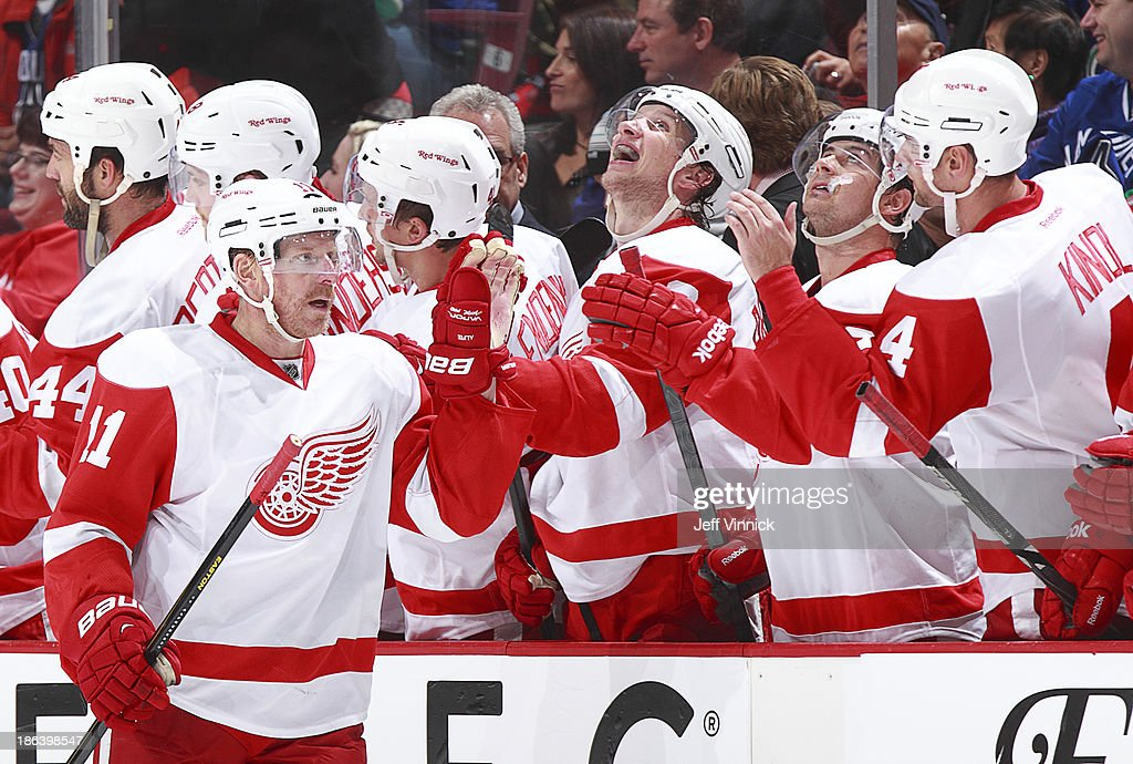 <a gi-track='captionPersonalityLinkClicked' href=/galleries/search?phrase=Daniel+Alfredsson&family=editorial&specificpeople=201853 ng-click='$event.stopPropagation()'>Daniel Alfredsson</a> #11 of the Detroit Red Wings is congratulated at the bench after scoring against the Vancouver Canucks during their NHL game at Rogers Arena on October 30, 2013 in Vancouver, British Columbia, Canada.