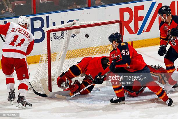 Daniel Alfredsson of the Detroit Red Wings scores a goal against Goaltender Tim Thomas of the Florida Panthers at the BBT Center on February 6 2014...