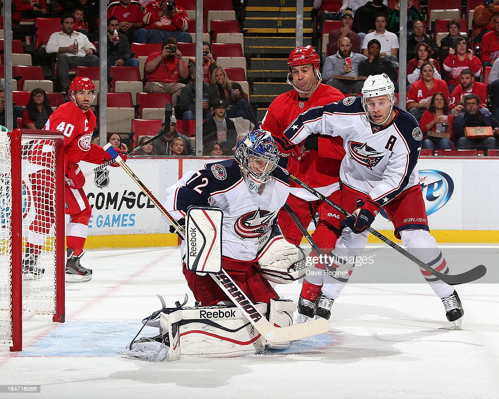 Daniel Alfredsson #11 of the Detroit Red Wings (not pictured) scores a goal on <a gi-track='captionPersonalityLinkClicked' href=/galleries/search?phrase=Sergei+Bobrovsky&family=editorial&specificpeople=4488556 ng-click='$event.stopPropagation()'>Sergei Bobrovsky</a> #72 of the Columbus Blue Jackets during a NHL game at Joe Louis Arena on October 15, 2013 in Detroit, Michigan.