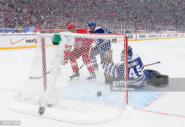 Daniel Alfredsson of the Detroit Red Wings scores past goaltender Jonathan Bernier of the Toronto Maple Leafs in the second period during the 2014...