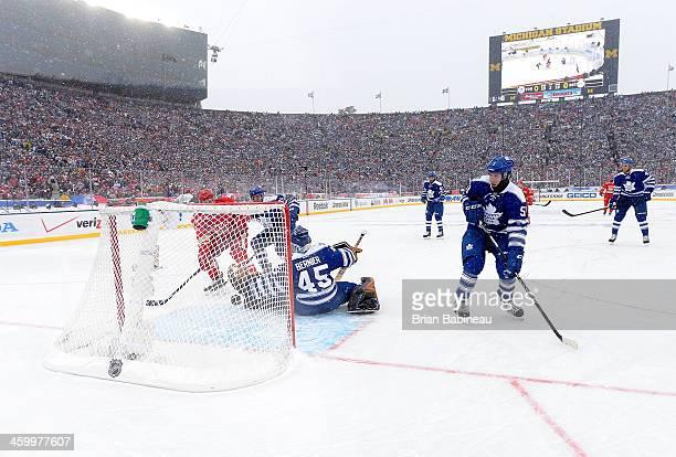Daniel Alfredsson of the Detroit Red Wings scores past goaltender Jonathan Bernier of the Toronto Maple Leafs as defenseman Jake Gardiner looks on in...