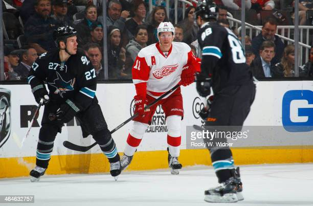 Daniel Alfredsson of the Detroit Red Wings skates against Scott Hannan of the San Jose Sharks at SAP Center on January 9 2014 in San Jose California