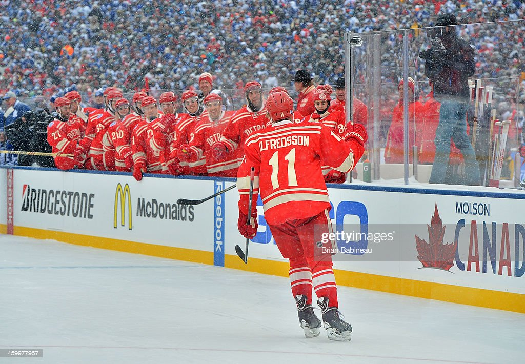 Daniel Alfredsson of the Detroit Red Wings skates to the Wings bench to celebrate after scoring in the second period against the Toronto Maple Leafs...