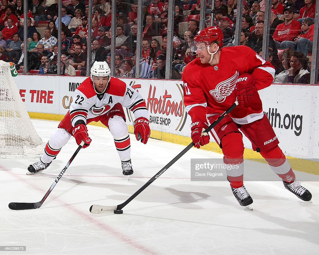 <a gi-track='captionPersonalityLinkClicked' href=/galleries/search?phrase=Daniel+Alfredsson&family=editorial&specificpeople=201853 ng-click='$event.stopPropagation()'>Daniel Alfredsson</a> #11 of the Detroit Red Wings skates with the puck as <a gi-track='captionPersonalityLinkClicked' href=/galleries/search?phrase=Manny+Malhotra&family=editorial&specificpeople=204479 ng-click='$event.stopPropagation()'>Manny Malhotra</a> #22 of the Carolina Hurricanes pressures him during an NHL game on April 11, 2014 at Joe Louis Arena in Detroit, Michigan.