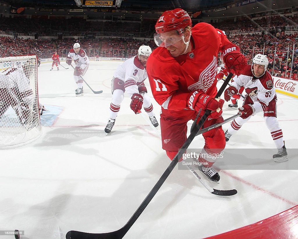 <a gi-track='captionPersonalityLinkClicked' href=/galleries/search?phrase=Daniel+Alfredsson&family=editorial&specificpeople=201853 ng-click='$event.stopPropagation()'>Daniel Alfredsson</a> #11 of the Detroit Red Wings skates with the puck in front of <a gi-track='captionPersonalityLinkClicked' href=/galleries/search?phrase=Derek+Morris&family=editorial&specificpeople=204188 ng-click='$event.stopPropagation()'>Derek Morris</a> #53 and <a gi-track='captionPersonalityLinkClicked' href=/galleries/search?phrase=Keith+Yandle&family=editorial&specificpeople=606912 ng-click='$event.stopPropagation()'>Keith Yandle</a> #3 of the Phoenix Coyotes during a NHL game at Joe Louis Arena on October 10, 2013 in Detroit, Michigan. The Coyotes won 4-2
