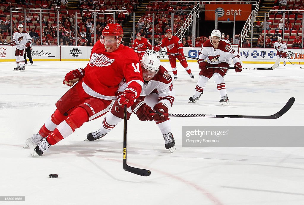 <a gi-track='captionPersonalityLinkClicked' href=/galleries/search?phrase=Daniel+Alfredsson&family=editorial&specificpeople=201853 ng-click='$event.stopPropagation()'>Daniel Alfredsson</a> #11 of the Detroit Red Wings tries to hold off <a gi-track='captionPersonalityLinkClicked' href=/galleries/search?phrase=Mikkel+Boedker&family=editorial&specificpeople=4697252 ng-click='$event.stopPropagation()'>Mikkel Boedker</a> #89 of the Phoenix Coyotes during the third period at Joe Louis Arena on October 10, 2013 in Detroit, Michigan. Phoenix won the game 4-2.