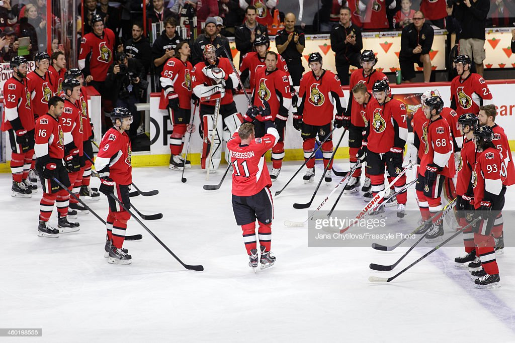Daniel Alfredsson of the Ottawa Senators acknowledges the fans as he leaves the ice on the day he signed a one day contract and then announced his...