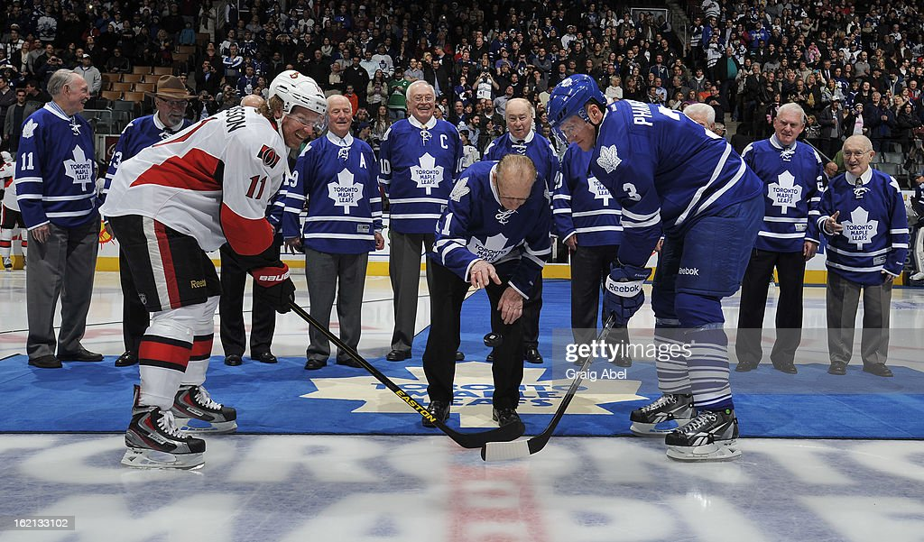 Daniel Alfredsson #11 of the Ottawa Senators and Dion Phaneuf #3 of the Toronto Maple Leafs take part in an ice ceremony with Toronto Maple Leafs Alumnus Johnny Bower and members of the 1963 Stanley Cup winning team prior to NHL game action February 16, 2013 at the Air Canada Centre in Toronto, Ontario, Canada.