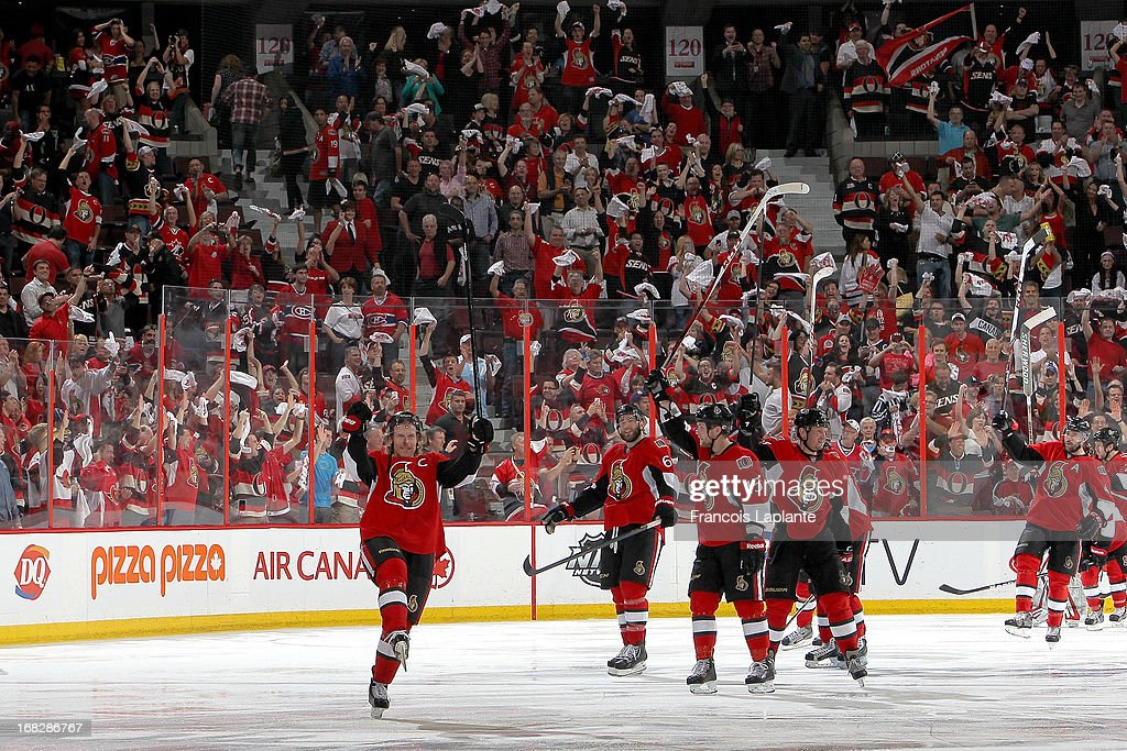 <a gi-track='captionPersonalityLinkClicked' href=/galleries/search?phrase=Daniel+Alfredsson&family=editorial&specificpeople=201853 ng-click='$event.stopPropagation()'>Daniel Alfredsson</a> #11 of the Ottawa Senators and his teammates salute the crowd after their overtime win against the Montreal Canadiens in Game Four of the Eastern Conference Quarterfinals during the 2013 NHL Stanley Cup Playoffs at Scotiabank Place on May 7, 2013 in Ottawa, Ontario, Canada.