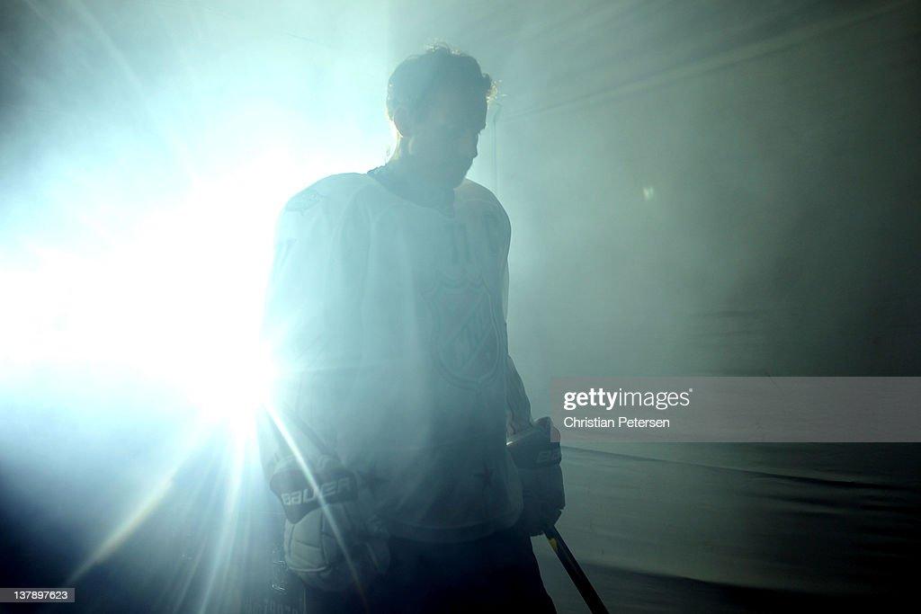 Daniel Alfredsson of the Ottawa Senators and Team Alfredsson walks on the ice prior to the 2012 Tim Hortons NHL AllStar Game against Team Chara at...