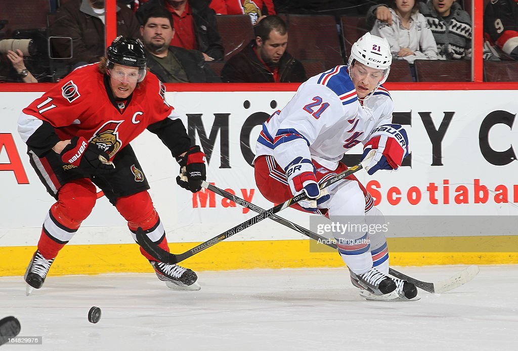 Daniel Alfredsson #11 of the Ottawa Senators battles for the puck against Derek Stepan #21 of the New York Rangers on March 28, 2013 at Scotiabank Place in Ottawa, Ontario, Canada.