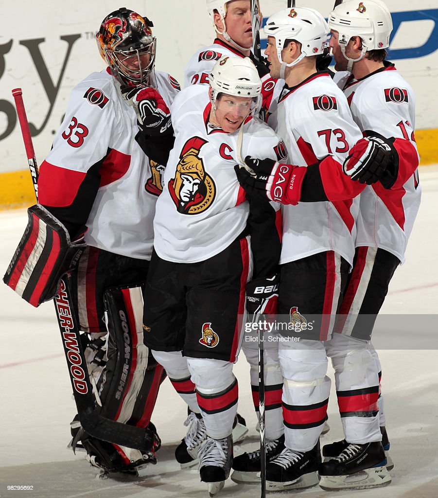 Daniel Alfredsson of the Ottawa Senators celebrates a 52 win with teammates against the Florida Panthers at the BankAtlantic Center on April 6 2010...