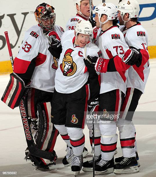 Daniel Alfredsson of the Ottawa Senators celebrates a 52 win with teammates against the Florida Panthers at the BankAtlantic Center on April 6 2010...
