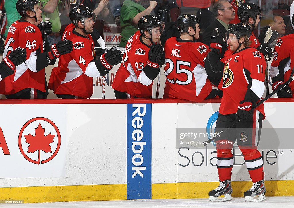 Daniel Alfredsson #11 of the Ottawa Senators celebrates a first period goal with teammates on the bench, during an NHL game against the Winnipeg Jets, at Scotiabank Place, on March 17, 2013 in Ottawa, Ontario, Canada.