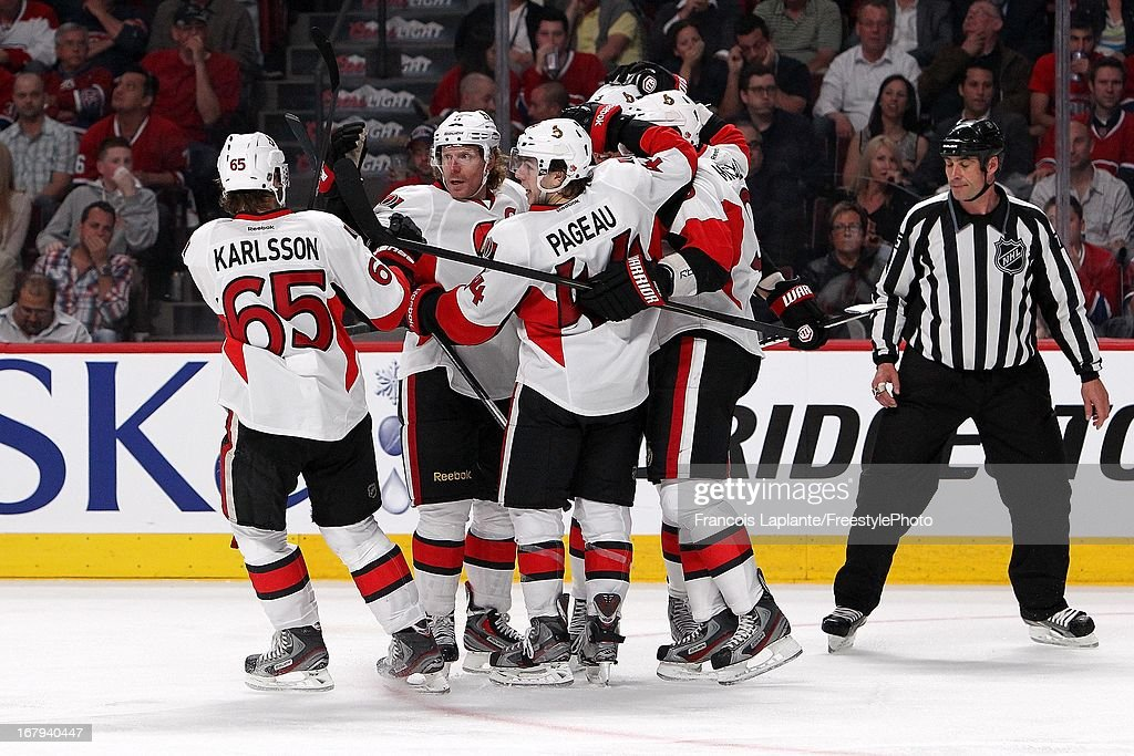 Daniel Alfredsson #11 of the Ottawa Senators celebrates a goal with teammates Erik Karlsson #65, Jean-Gabriel Pageau #44,Milan Michalek #9 and Marc Methot #3 in Game One of the Eastern Conference Quarterfinal during the 2013 NHL Stanley Cup Playoffs at the Bell Centre on May 2, 2013 in Montreal, Quebec, Canada.