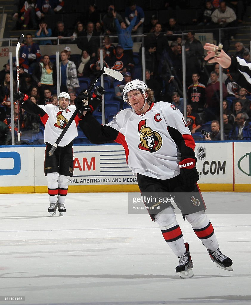 <a gi-track='captionPersonalityLinkClicked' href=/galleries/search?phrase=Daniel+Alfredsson&family=editorial&specificpeople=201853 ng-click='$event.stopPropagation()'>Daniel Alfredsson</a> #11 of the Ottawa Senators celebrates an empty net goal by <a gi-track='captionPersonalityLinkClicked' href=/galleries/search?phrase=Guillaume+Latendresse&family=editorial&specificpeople=848999 ng-click='$event.stopPropagation()'>Guillaume Latendresse</a> #73 (not shown) at 19:51 of the third period against the New York Islanders at the Nassau Veterans Memorial Coliseum on March 19, 2013 in Uniondale, New York. For Alfredsson that was his 1,100th NHL point