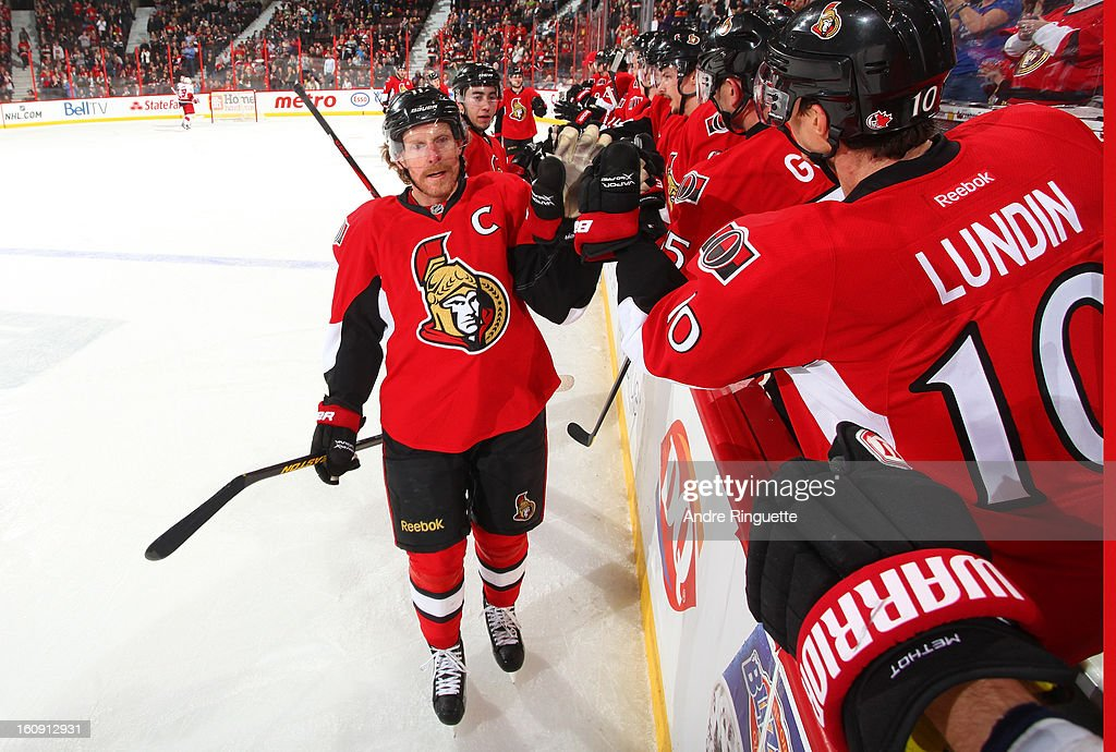 Daniel Alfredsson #11 of the Ottawa Senators celebrates his second period goal against the Carolina Hurricanes with teammate Mike Lundin #10 on February 7, 2013 at Scotiabank Place in Ottawa, Ontario, Canada.