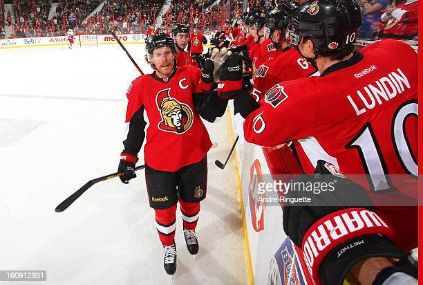 Daniel Alfredsson of the Ottawa Senators celebrates his second period goal against the Carolina Hurricanes with teammate Mike Lundin on February 7...