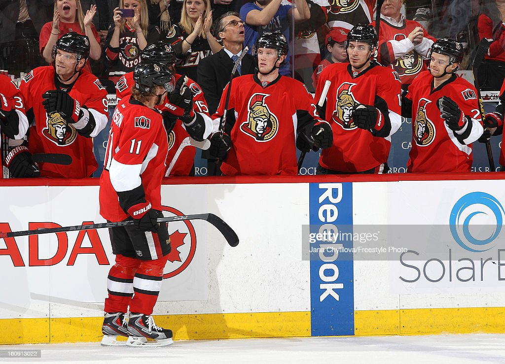 Daniel Alfredsson #11 of the Ottawa Senators celebrates his second period goal with team mates Milan Michalek #9, Erik Condra #22, Jim O'Brien #18, and Stephane Da Costa #24, during an NHL game against the Carolina Hurricanes at Scotiabank Place on February 7, 2013 in Ottawa, Ontario, Canada.