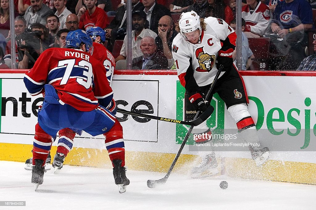 Daniel Alfredsson #11 of the Ottawa Senators controls the puck against Brian Gionta #21 and Michael Ryder #73 of the Montreal Canadiens in Game One of the Eastern Conference Quarterfinal during the 2013 NHL Stanley Cup Playoffs at the Bell Centre on May 2, 2013 in Montreal, Quebec, Canada.