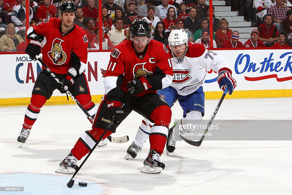 <a gi-track='captionPersonalityLinkClicked' href=/galleries/search?phrase=Daniel+Alfredsson&family=editorial&specificpeople=201853 ng-click='$event.stopPropagation()'>Daniel Alfredsson</a> #11 of the Ottawa Senators controls the puck against <a gi-track='captionPersonalityLinkClicked' href=/galleries/search?phrase=Michael+Ryder&family=editorial&specificpeople=208983 ng-click='$event.stopPropagation()'>Michael Ryder</a> #73 ofthe Montreal Canadiens in Game Four of the Eastern Conference Quarterfinals during the 2013 NHL Stanley Cup Playoffs at Scotiabank Place on May 7, 2013 in Ottawa, Ontario, Canada.