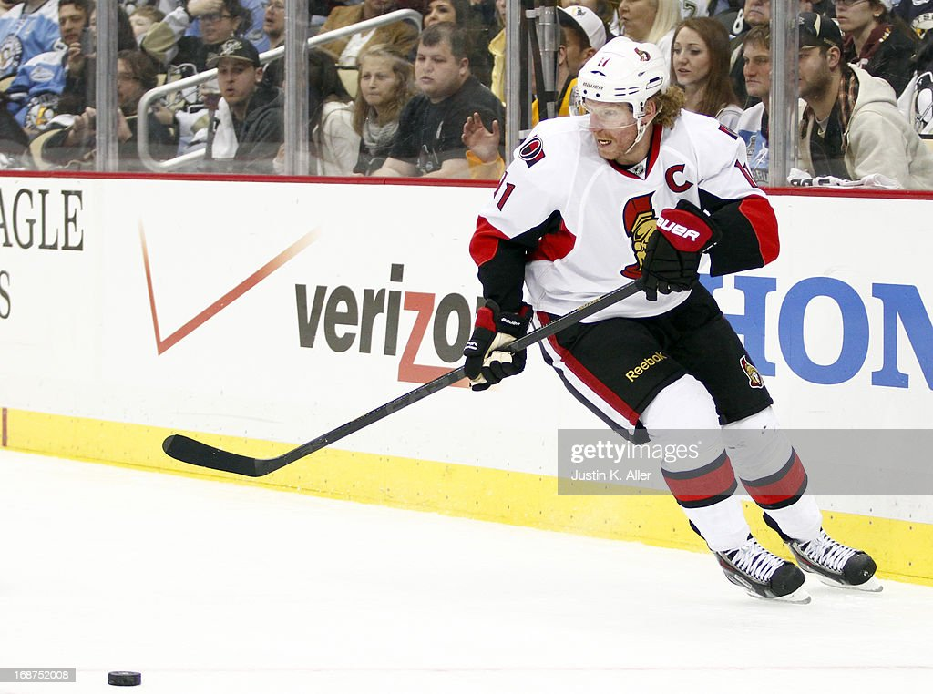 Daniel Alfredsson #11 of the Ottawa Senators handles the puck against the Pittsburgh Penguins in Game One of the Eastern Conference Semifinals during the 2013 NHL Stanley Cup Playoffs at Consol Energy Center on May 14, 2013 in Pittsburgh, Pennsylvania. The Penguins defeated the Senators 4-1.