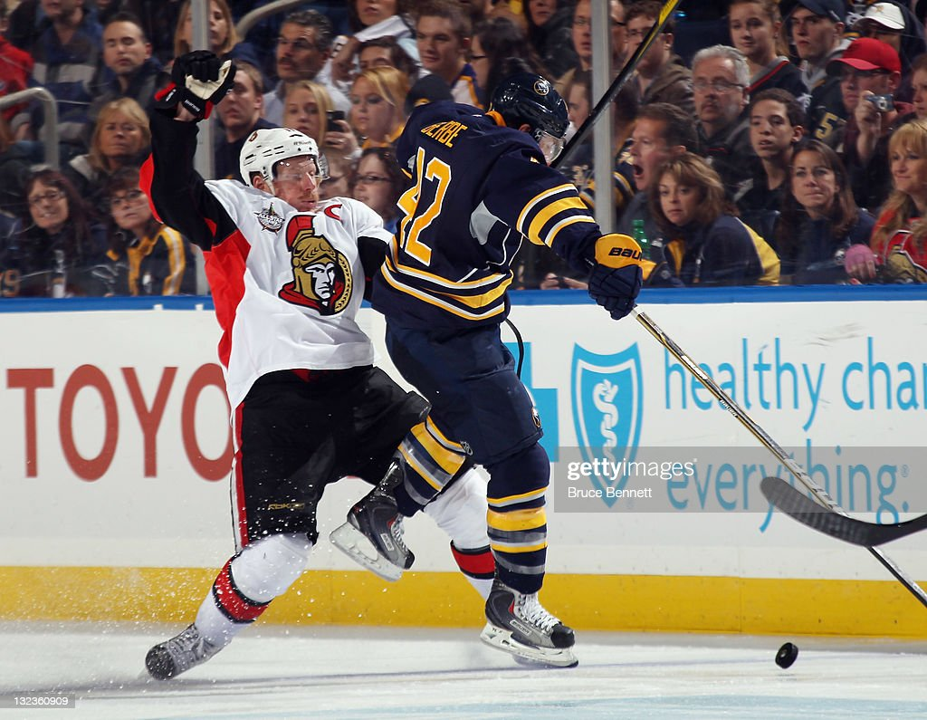 <a gi-track='captionPersonalityLinkClicked' href=/galleries/search?phrase=Daniel+Alfredsson&family=editorial&specificpeople=201853 ng-click='$event.stopPropagation()'>Daniel Alfredsson</a> #11 of the Ottawa Senators is hit by <a gi-track='captionPersonalityLinkClicked' href=/galleries/search?phrase=Nathan+Gerbe&family=editorial&specificpeople=697084 ng-click='$event.stopPropagation()'>Nathan Gerbe</a> #42 of the Buffalo Sabres at the First Niagara Center on November 11, 2011 in Buffalo, New York. The Sabres defeated the Senators 5-1.