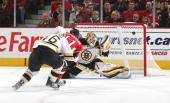 Daniel Alfredsson of the Ottawa Senators outskates David Krejci of the Boston Bruins and scores a short handed goal against Tim Thomas of the Boston...