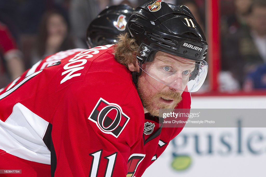 Daniel Alfredsson #11 of the Ottawa Senators prepares for a faceoff during an NHL game against the New York Rangers at Scotiabank Place on February 21, 2013 in Ottawa, Ontario, Canada.