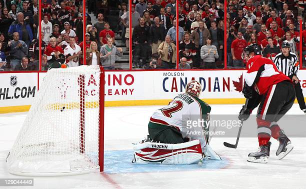 Daniel Alfredsson of the Ottawa Senators scores a shootout goal against Niklas Backstrom of the Minnesota Wild at Scotiabank Place on October 11 2011...