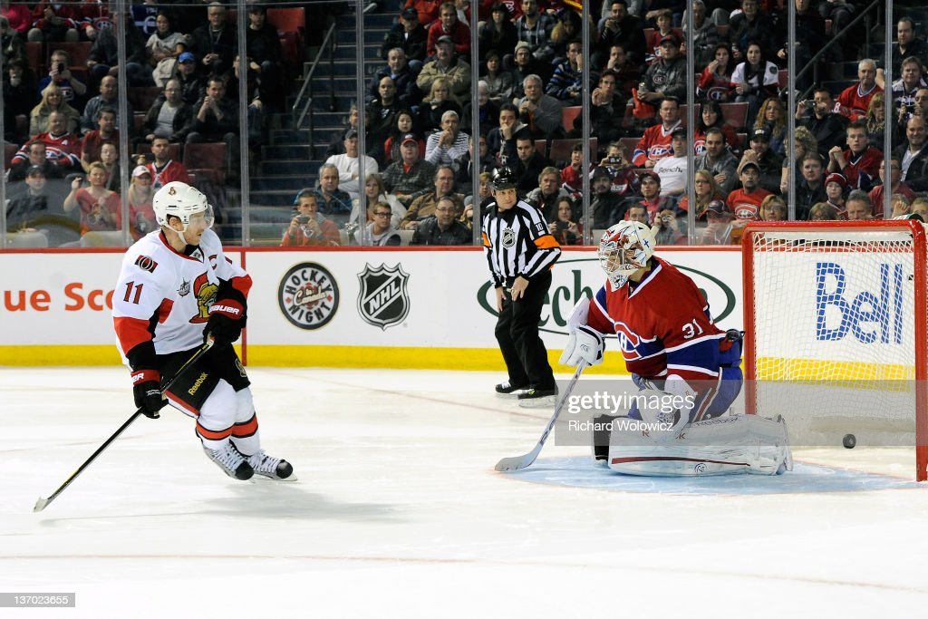 Daniel Alfredsson of the Ottawa Senators scores the game winning goal during the shootout against Carey Price of the Montreal Canadiens during the...