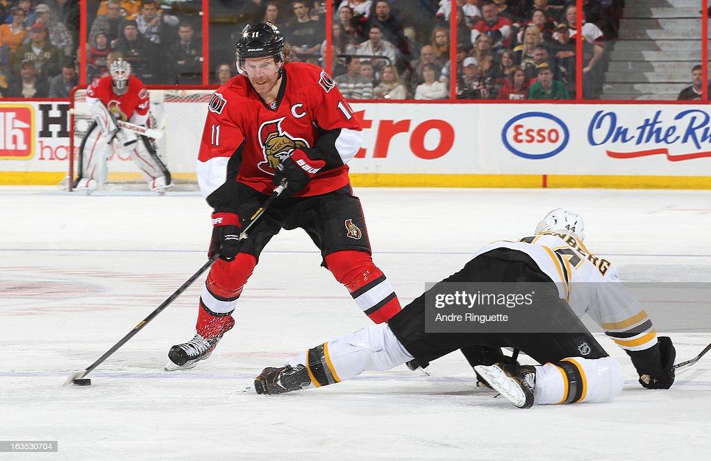 <a gi-track='captionPersonalityLinkClicked' href=/galleries/search?phrase=Daniel+Alfredsson&family=editorial&specificpeople=201853 ng-click='$event.stopPropagation()'>Daniel Alfredsson</a> #11 of the Ottawa Senators skates around <a gi-track='captionPersonalityLinkClicked' href=/galleries/search?phrase=Dennis+Seidenberg&family=editorial&specificpeople=204616 ng-click='$event.stopPropagation()'>Dennis Seidenberg</a> #44 of the Boston Bruins with the puck on March 11, 2013 at Scotiabank Place in Ottawa, Ontario, Canada.