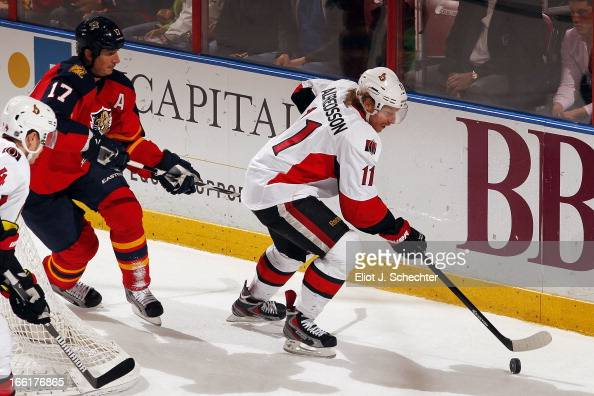 Daniel Alfredsson of the Ottawa Senators skates with the puck against Filip Kuba of the Florida Panthers at the BBT Center on April 7 2013 in Sunrise...