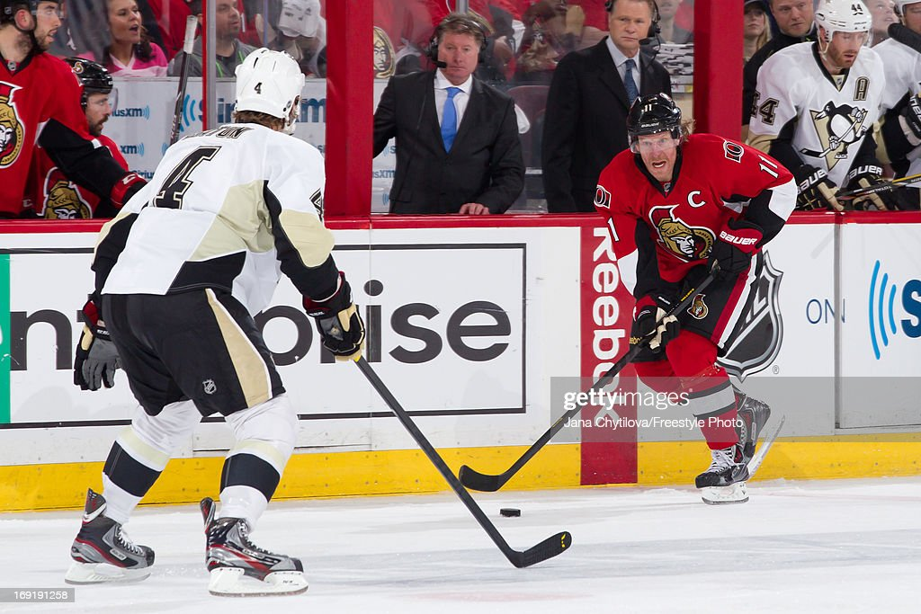 Daniel Alfredsson #11 of the Ottawa Senators stickhandles the puck against Mark Eaton #4 of the Pittsburgh Penguins in Game Three of the Eastern Conference Semifinals during the 2013 NHL Stanley Cup Playoffs, at Scotiabank Place, on May 19, 2013 in Ottawa, Ontario, Canada.